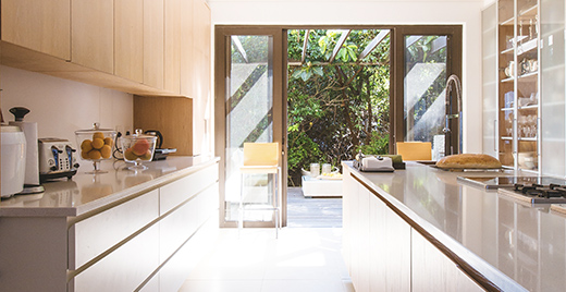 Picture of a kitchen with open patio doors